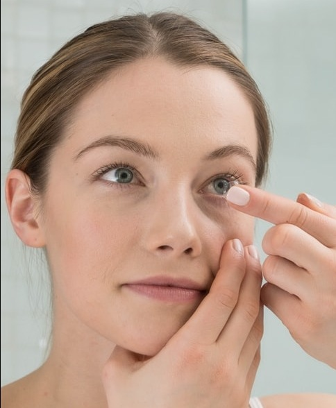 Girl inserting Contact Lens